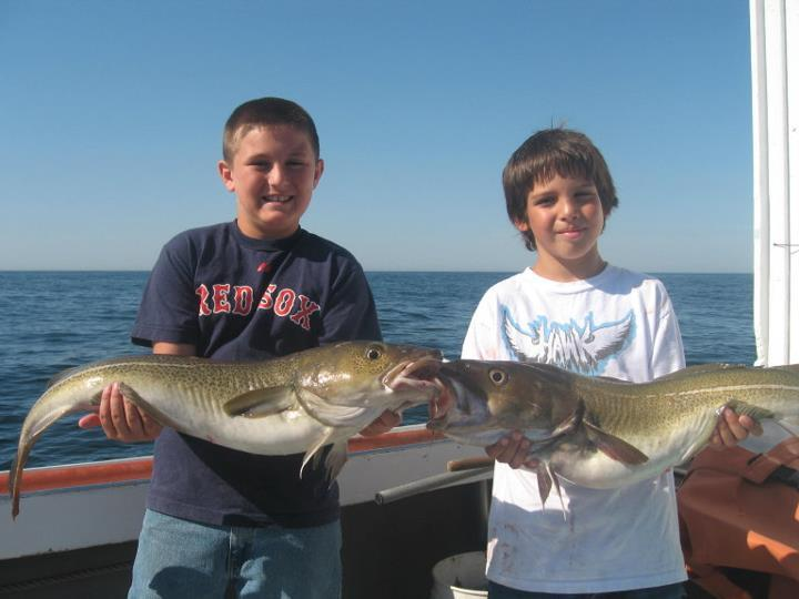 charter fishing kids with cod