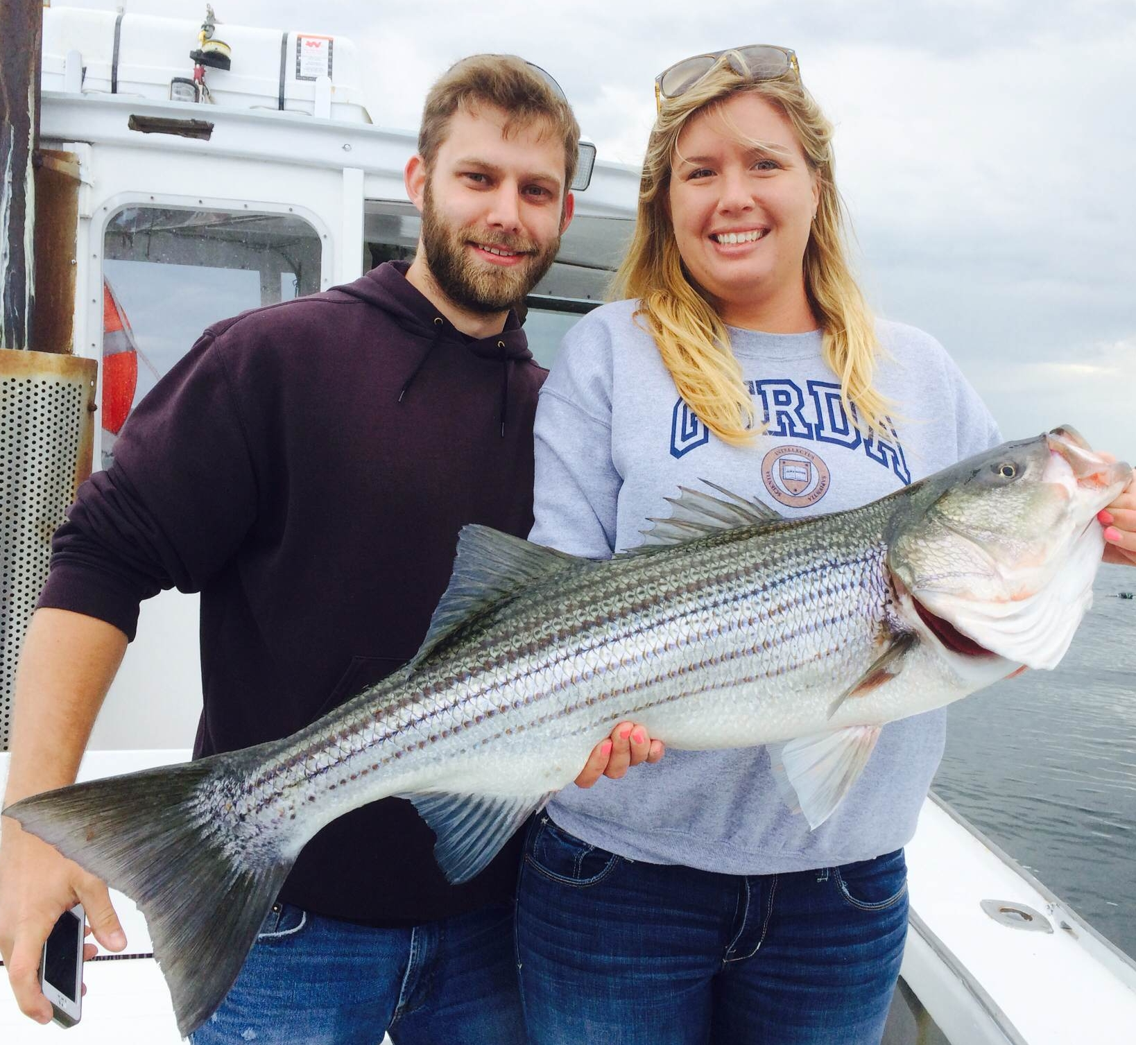 First striped bass of 2014 caught charter fishing for Deep sea fishing gloucester ma